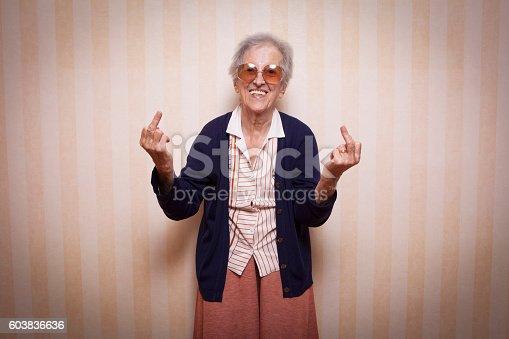 587932042istockphoto cool elder lady making middle finger sign 603836636
