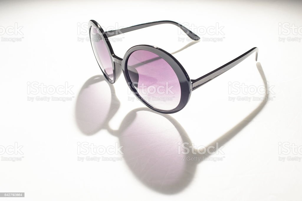 Cool Funky Plastic Sunglasses on White Background stock photo