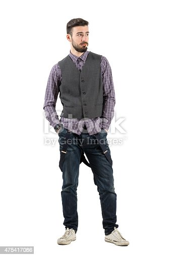 istock Cool funky young man with cigarette looking away 475417086