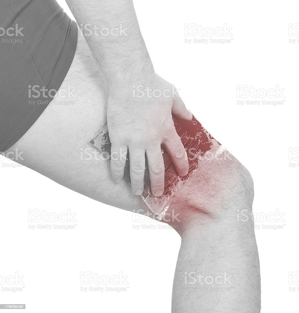 Cool gel pack on a swollen hurting calf. royalty-free stock photo