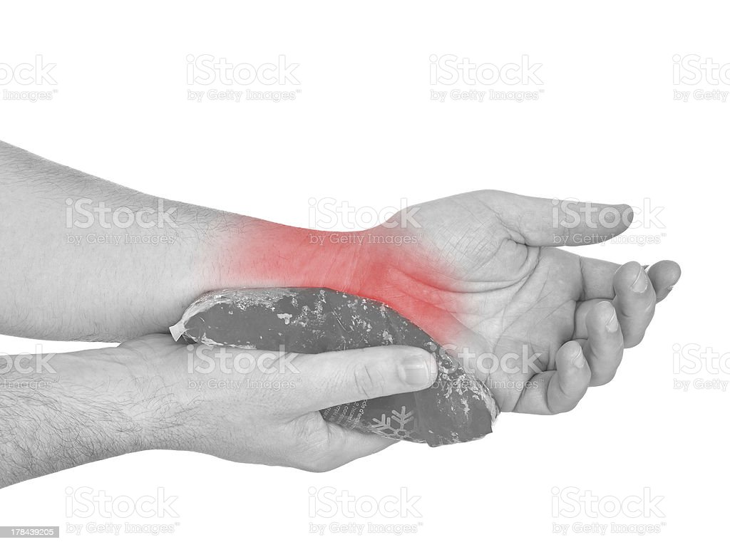 Cool gel pack on a swollen hurting wrist. royalty-free stock photo