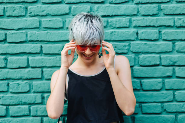 cool girl with sunglasses posing - showus стоковые фото и изображения