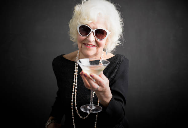cool grandma havinga a drink - drunk stock photos and pictures