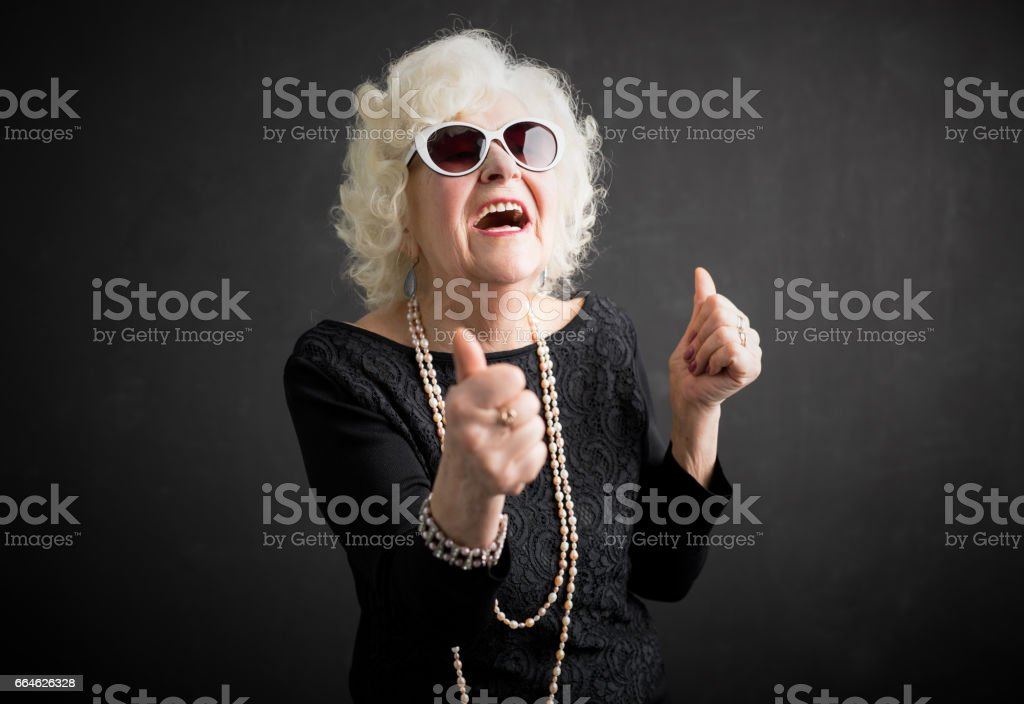 Cool grandma with her thumbs up – zdjęcie