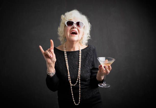 cool grandmother with sunglasses and drink in hand - rock music stock pictures, royalty-free photos & images