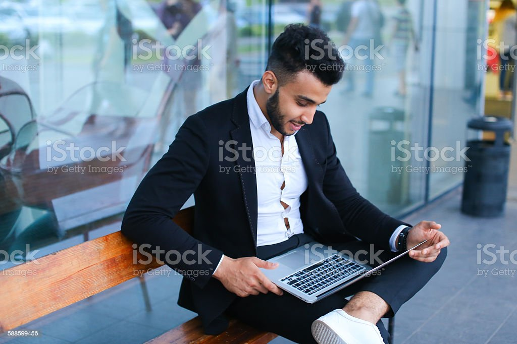 Phenomenal Cool Guy Arabic Man Uses Laptop Business Center Stockfoto Download Free Architecture Designs Rallybritishbridgeorg