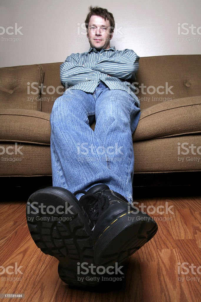 cool guy resting on couch royalty-free stock photo