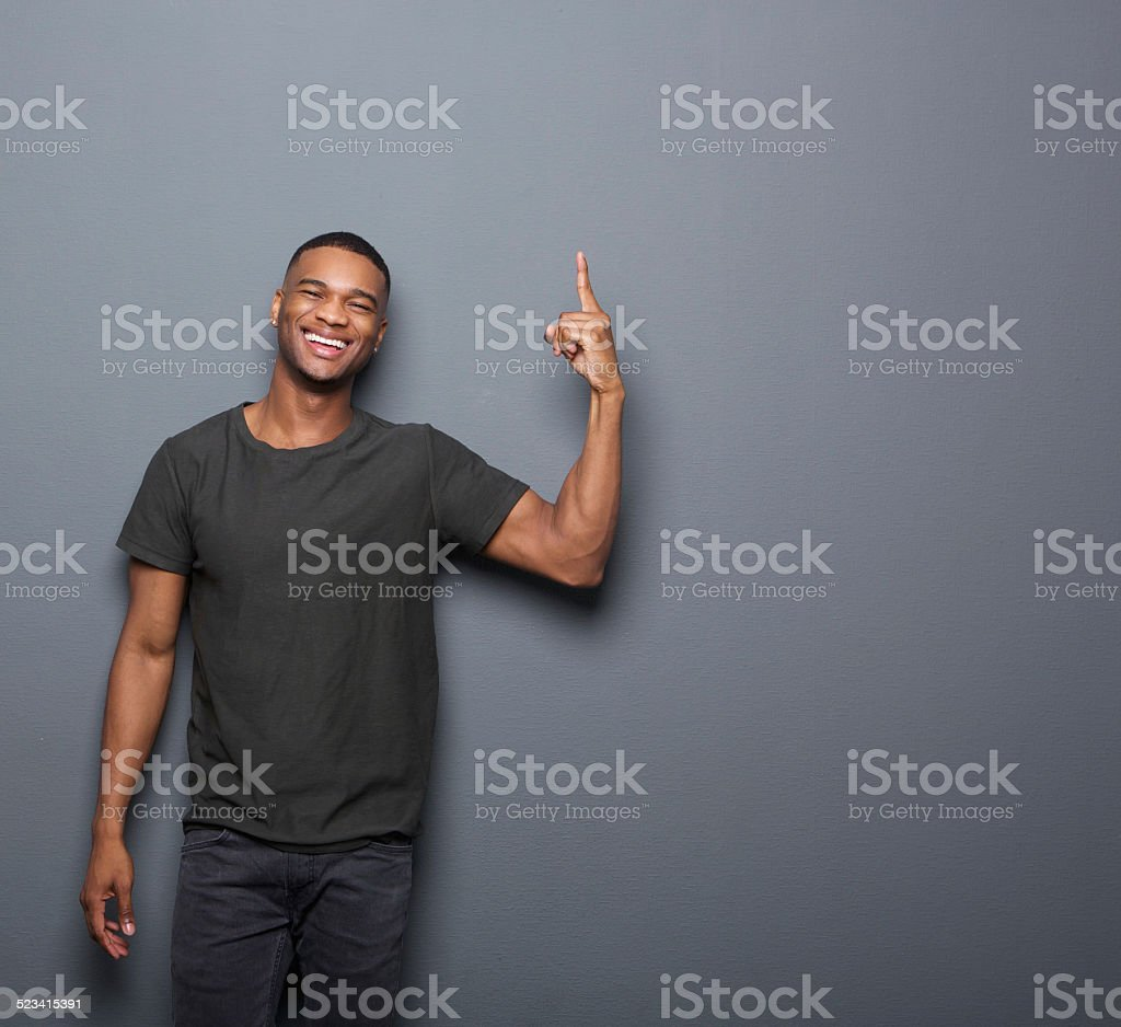 Cool guy smiling and pointing finger stock photo