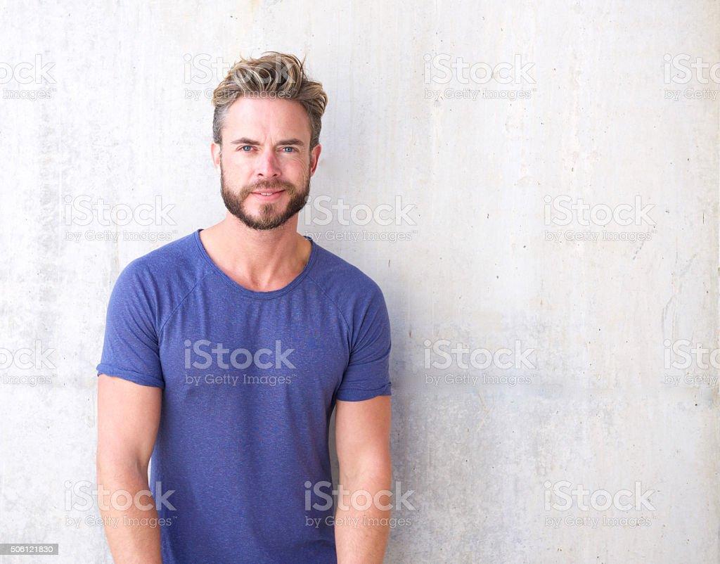 Cool guy with beard and purple shirt stock photo