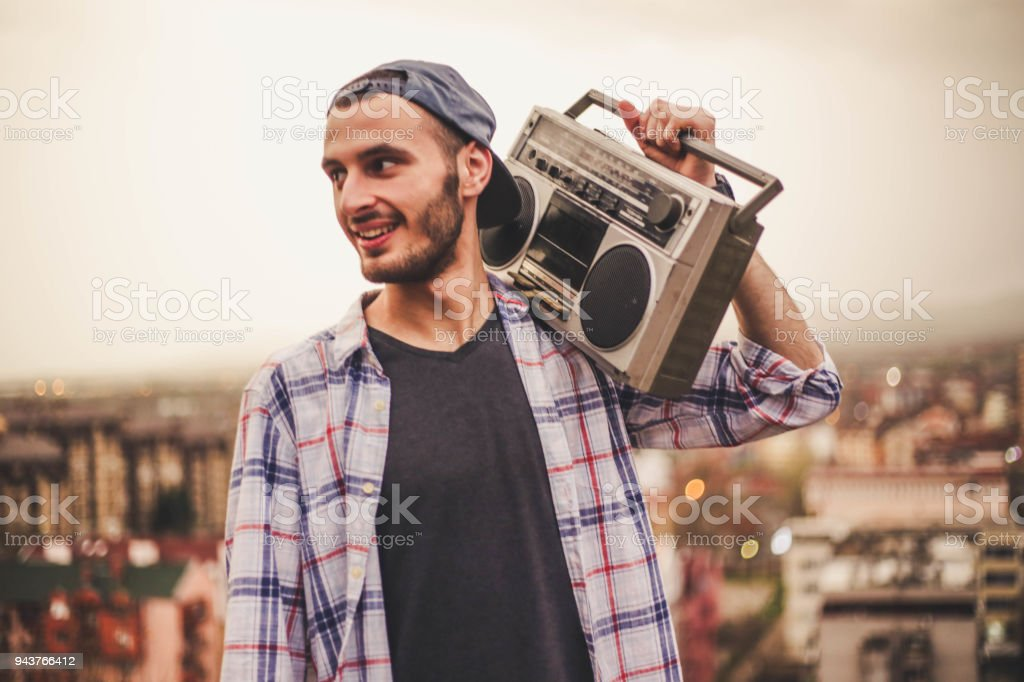 Cool guy with boom box on shoulder stock photo