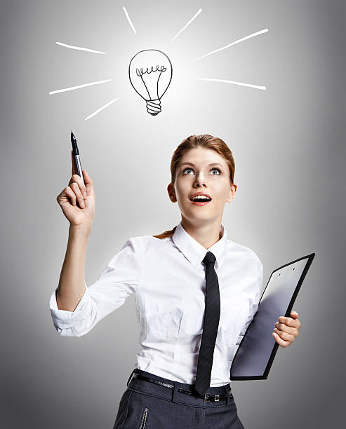 Cool idea attractive woman wearing a white shirt with a tie and a folder in her hand like the idea - on grey background deem stock pictures, royalty-free photos & images
