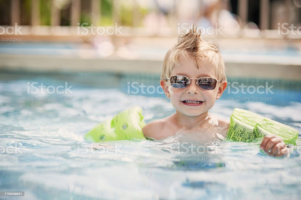 Cool little boy in swimming pool stock photo