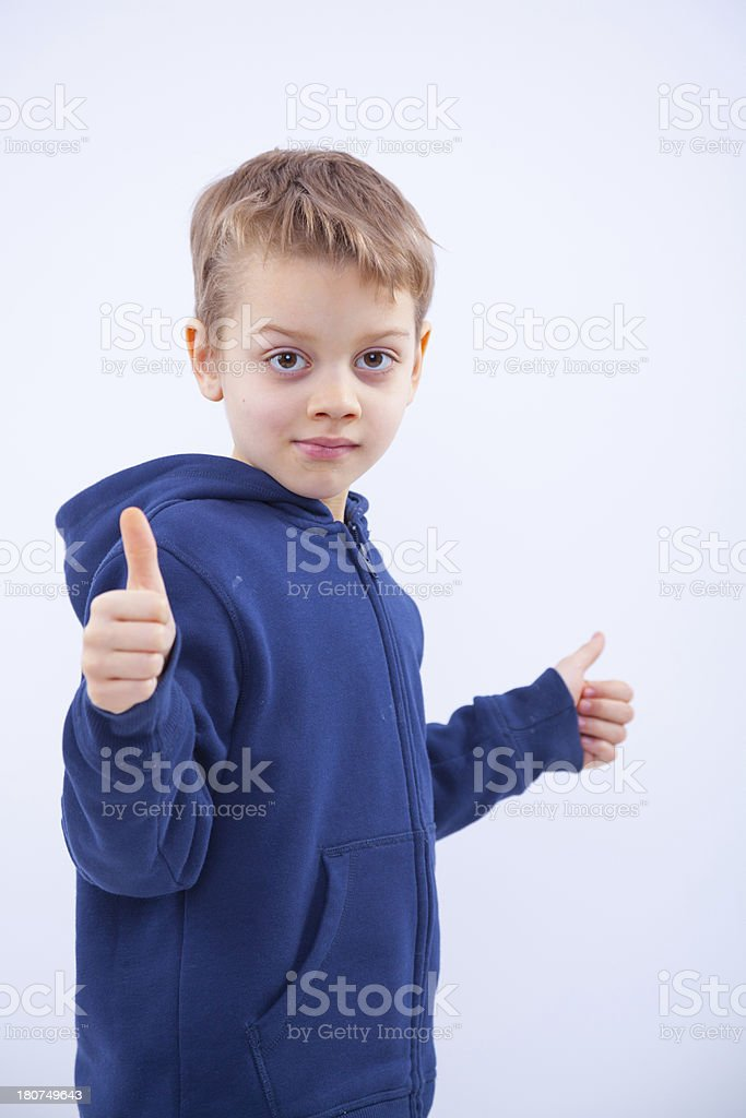 cool little boy with thumbs up over white background royalty-free stock photo