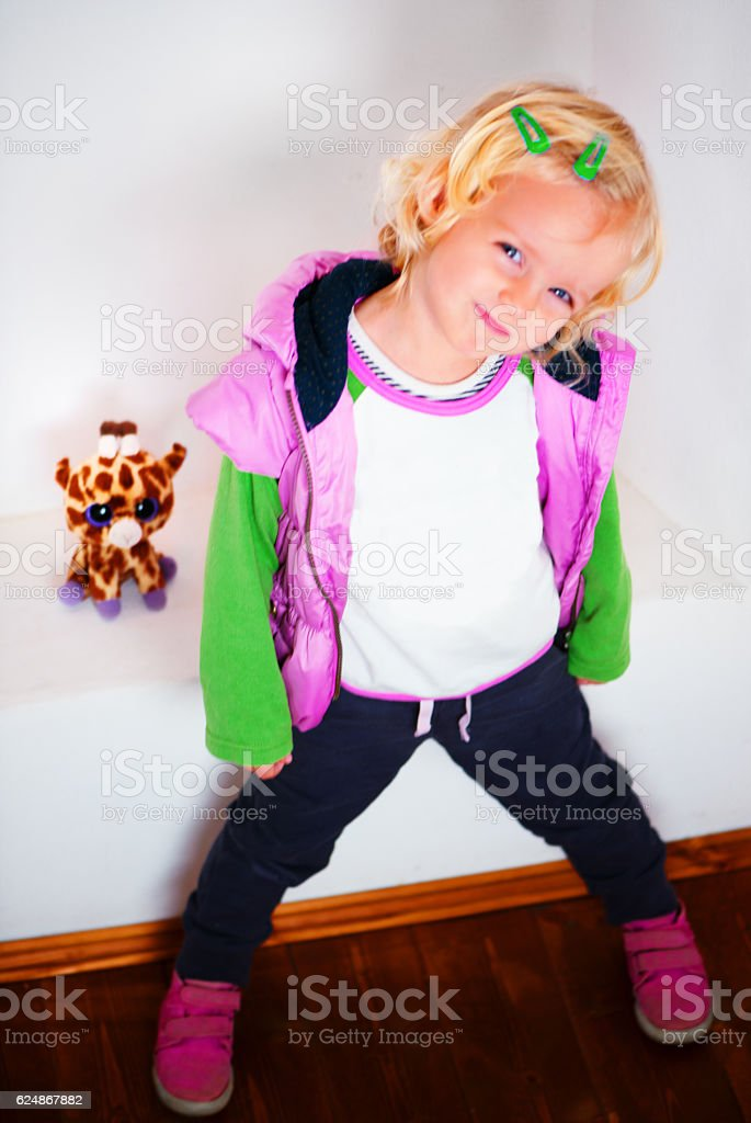 Cool Little Girl Looking at Camera stock photo