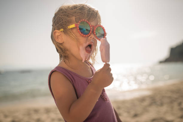 Cool little girl with icecream on summer holiday stock photo