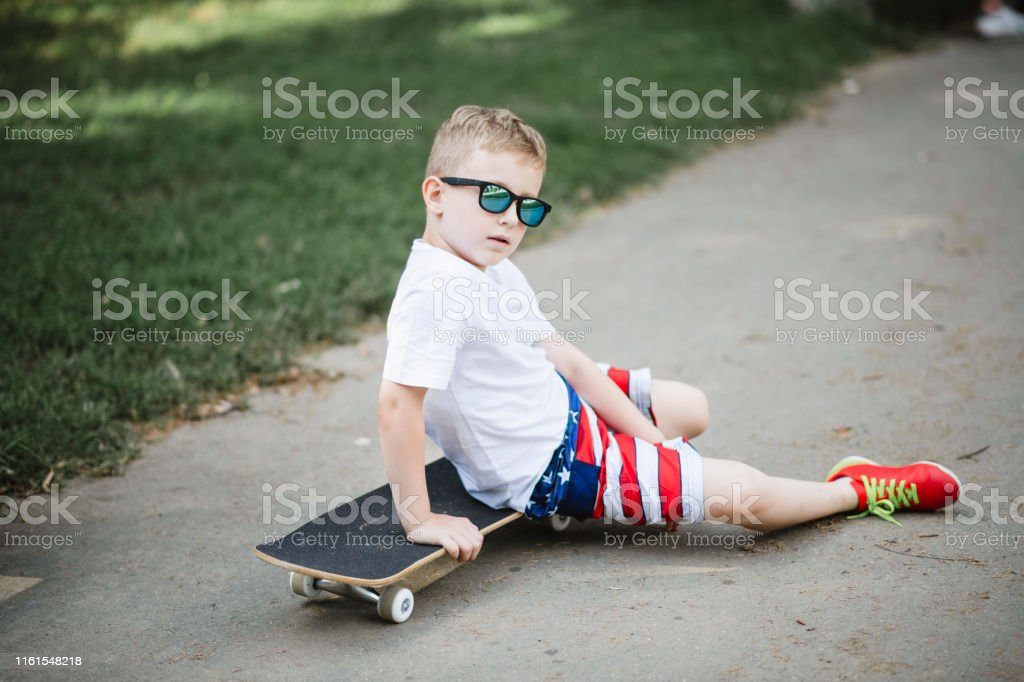 Cool Little Skater Sitting On A Skateboard In The Park Stock Images Page Everypixel