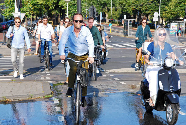 Cool looking and smart young people going to work by bike stock photo