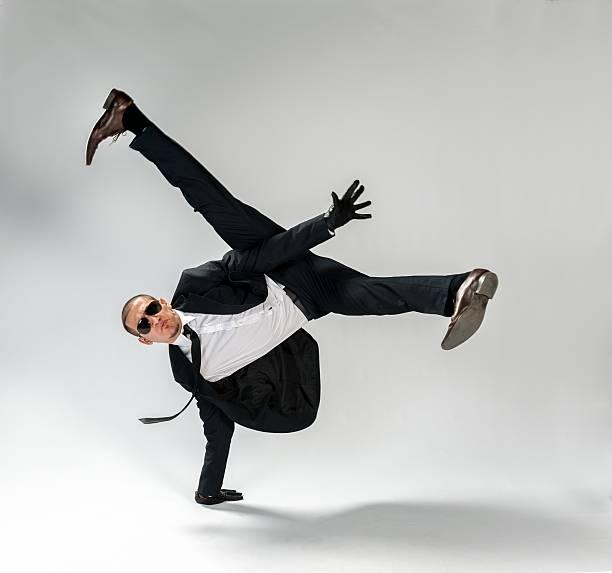 cool looking,breakdancing businessman, free run stock photo