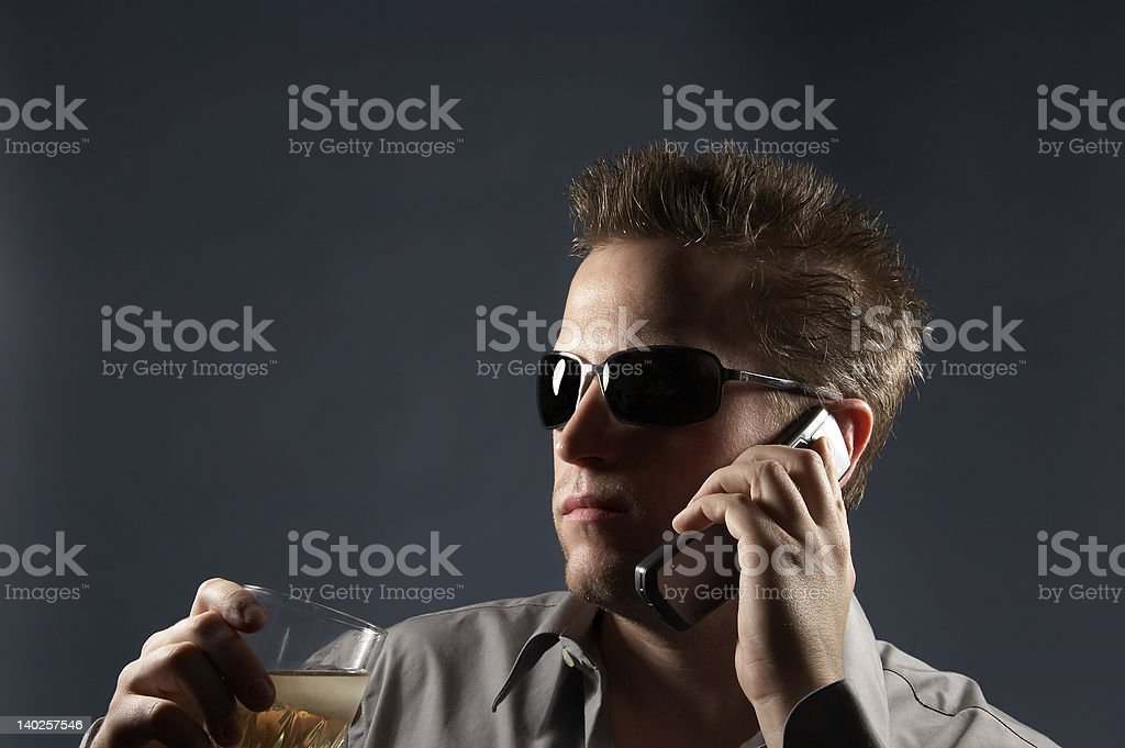 Cool Man on phone with drink royalty-free stock photo