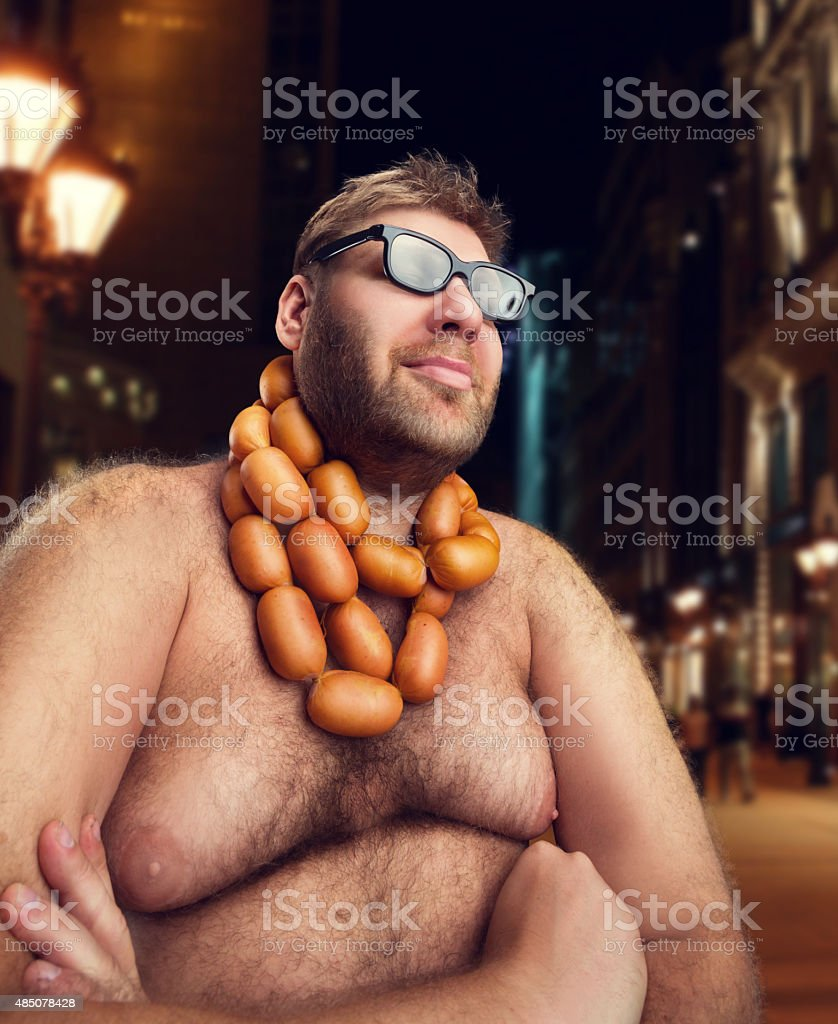 Cool man with sausages stock photo