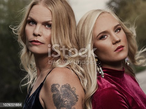 Cool modern women with confidence and pride Photo of two women one young adult and one mid adult. Standing up and being strong women.