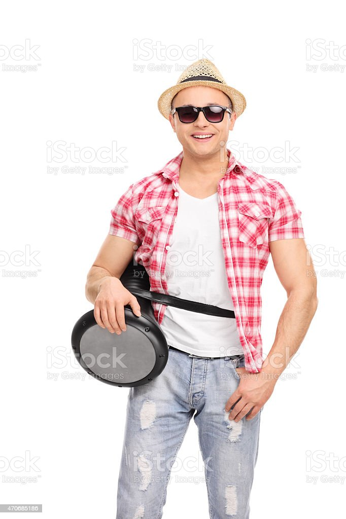 Cool musician with sunglasses holding a doumbek stock photo