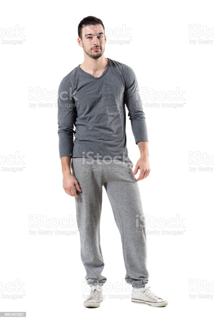 Cool relaxed fit man in sportswear looking at camera. stock photo