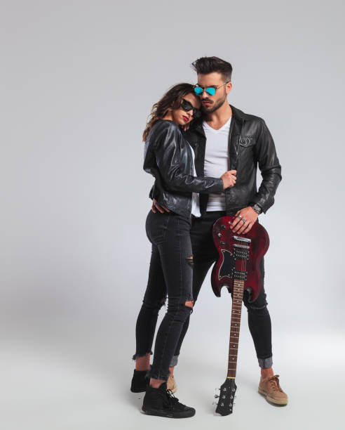 cool rock and roll couple standing embraced, - punk music stock photos and pictures