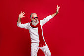 istock Cool santa character aged man drunk dancing at night club wear sun specs knitted clothes isolated red background 1179787087
