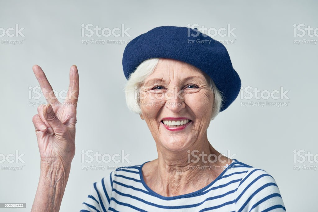Cool senior woman in beret stock photo
