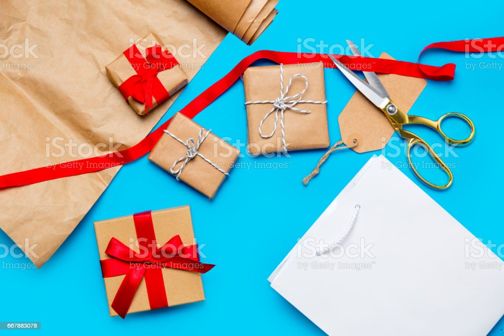 cool shopping bag, beautiful gifts and things for wrapping on the wonderful blue background royalty-free stock photo