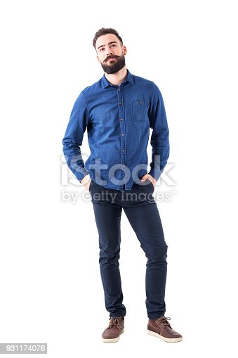 931173966istockphoto Cool smart casual young business man with cocked head looking at camera. 931174076