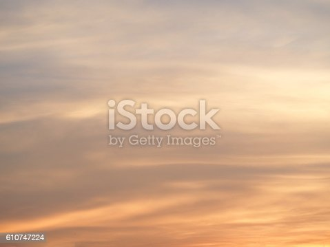 istock Cool soft orange sky with clouds in background, Pastel tone. 610747224