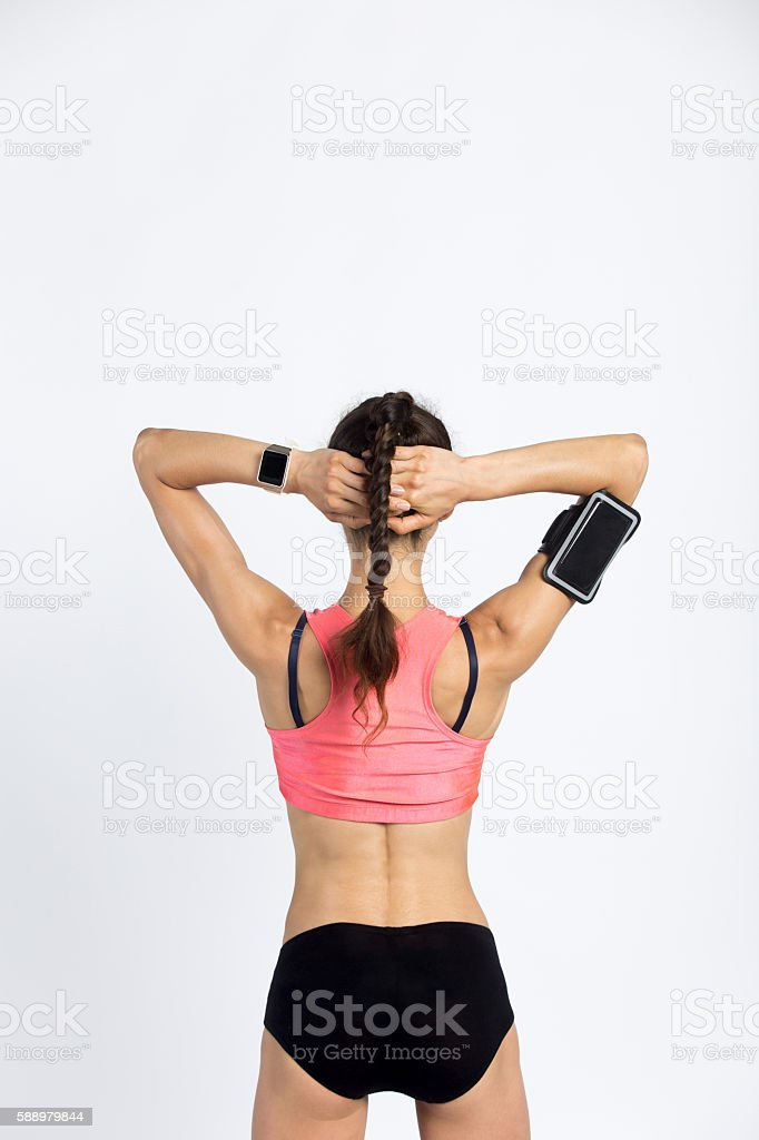 Cool sporty woman. Back view stock photo