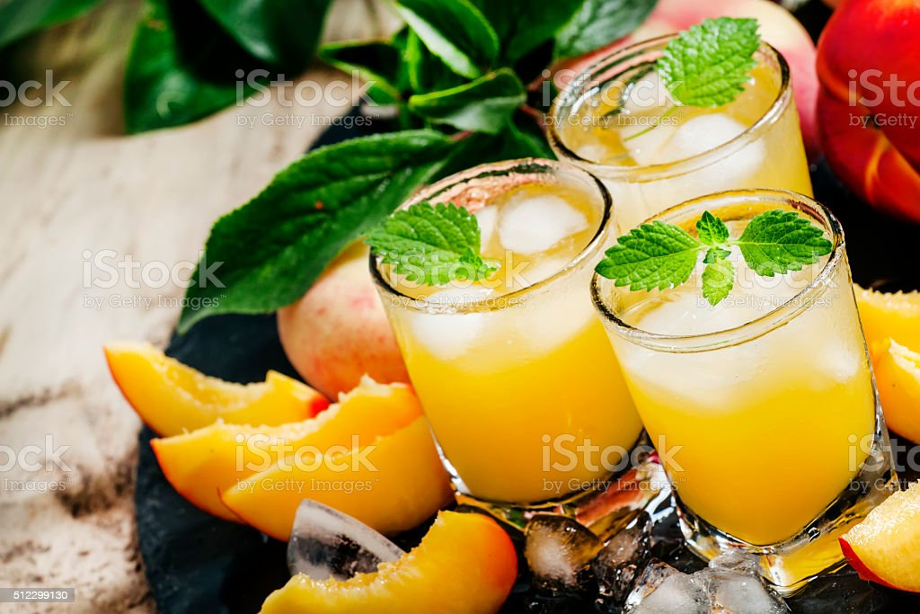 Cool summer peach juice with crushed ice stock photo