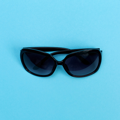 Cool Sunglasses On A Baby Blue Background Stock Photo - Download Image Now