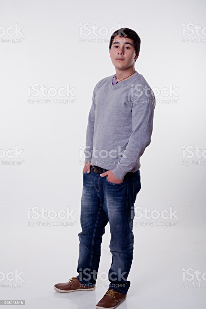 Cool Teenage Boy Standing Arms Crossed Stock Photo