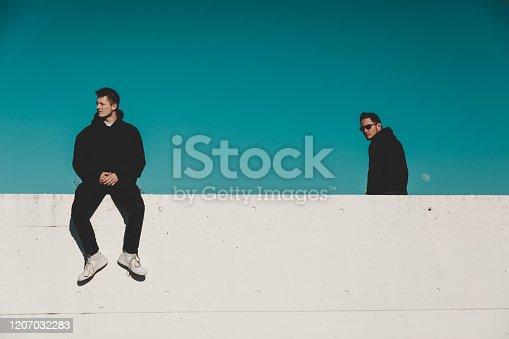 521022435 istock photo Cool Teenage Young Men on Garage Rooftop 1207032283
