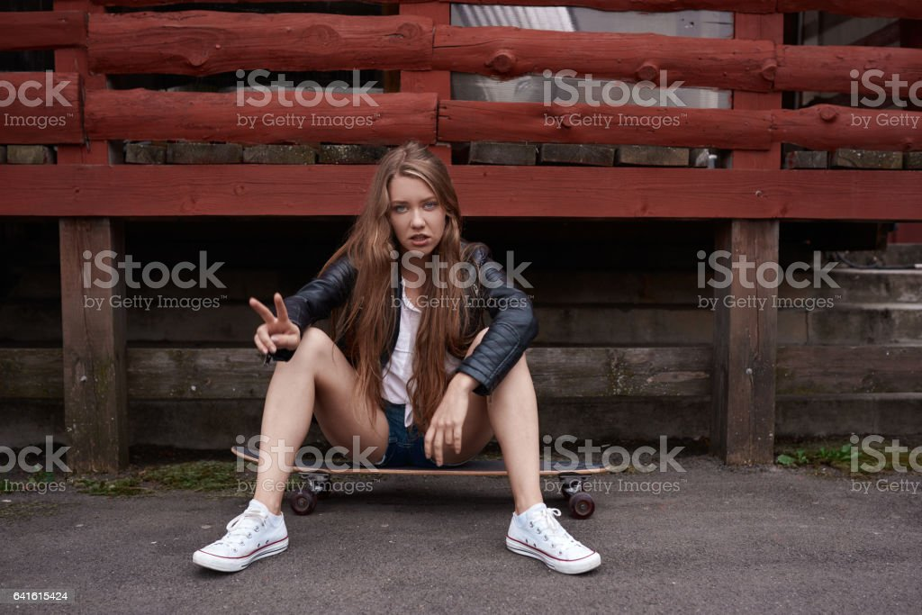 cool teenager woman on her skate stock photo