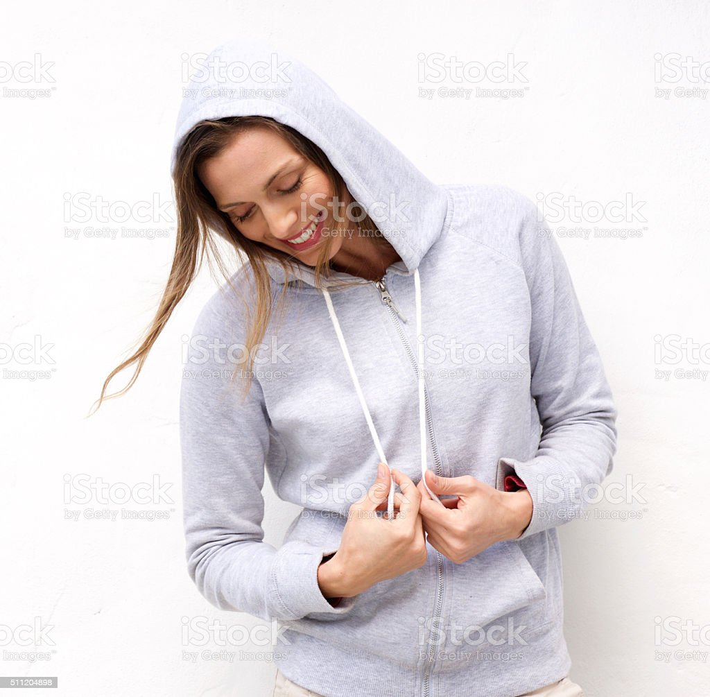 Cool woman laughing with hood sweatshirt stock photo