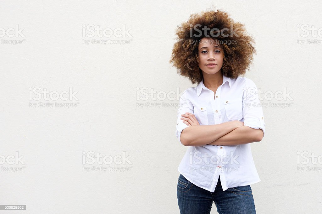 Cool young african american woman with curly hair stock photo