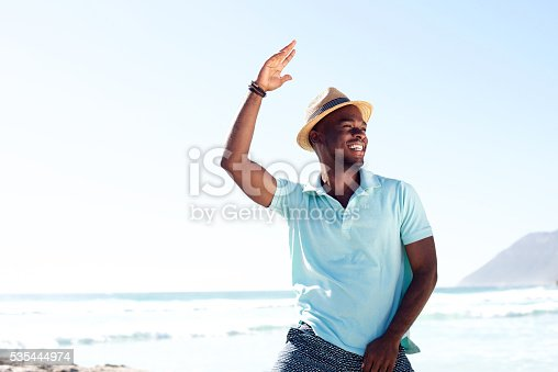 istock Cool young african man dancing at the beach 535444974