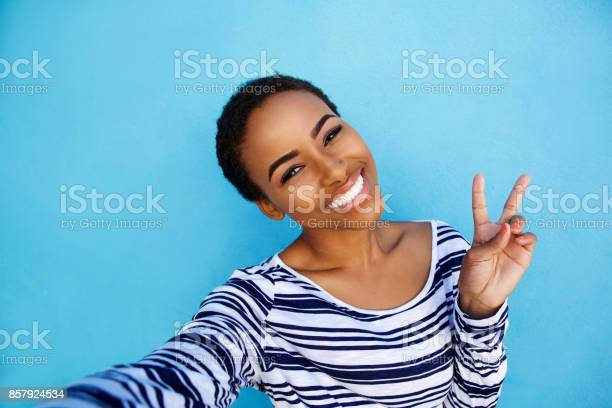 Cool young black woman taking selfie with peace hand sign picture id857924534?b=1&k=6&m=857924534&s=612x612&h=hmepvb8xucn0guk rlmphlx2pkx91tc4dcrwc3zqadq=