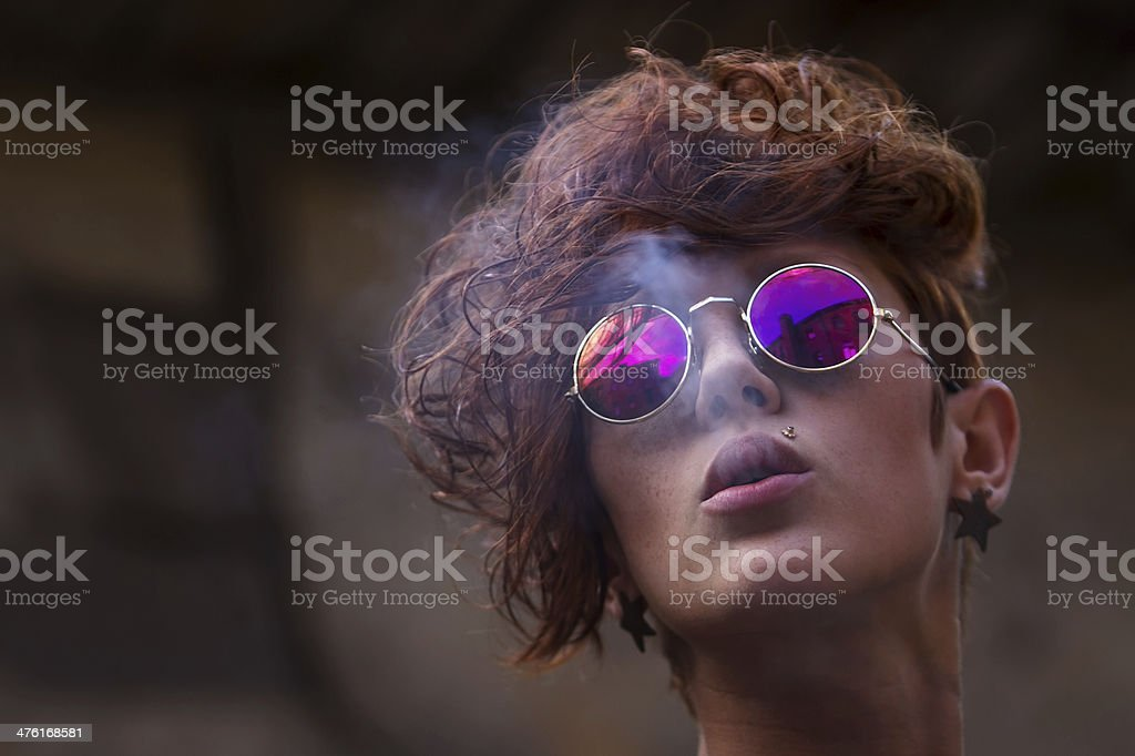 Cool young girl smoking tobacco stock photo