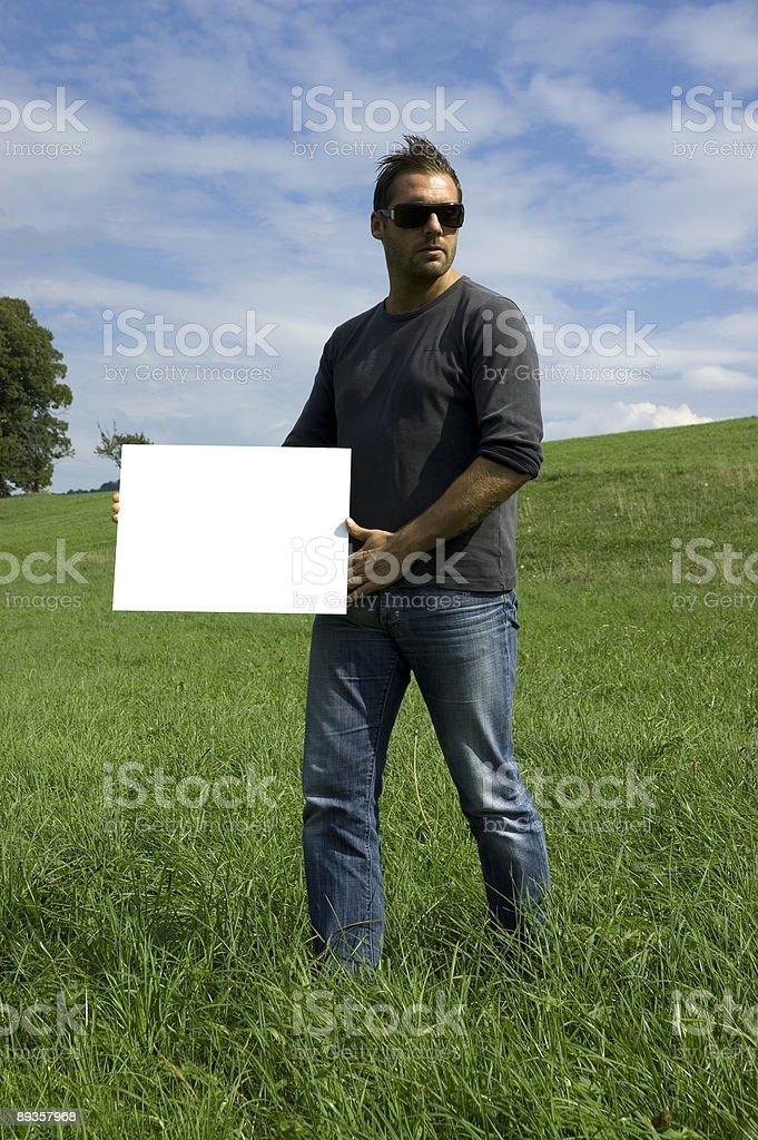 cool young guy presenting what you want royaltyfri bildbanksbilder