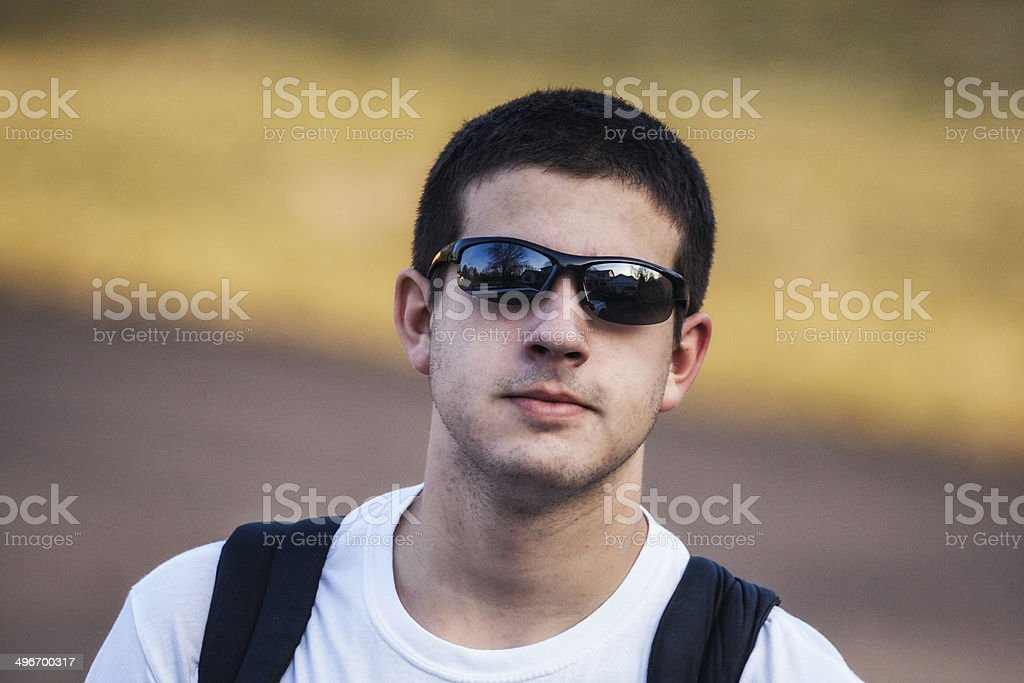 Cool Young Guy Wearing Sunglasses royalty-free stock photo