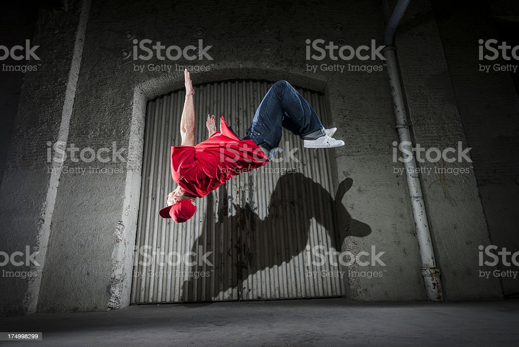 cool young man doing a backflip stock photo