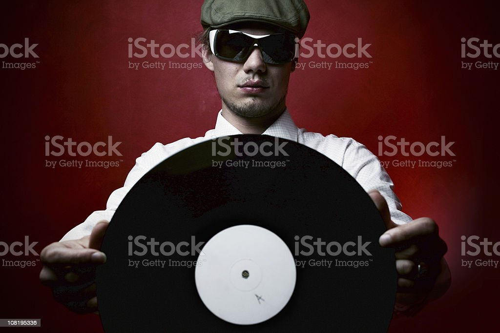 Cool Young man holding up record royalty-free stock photo