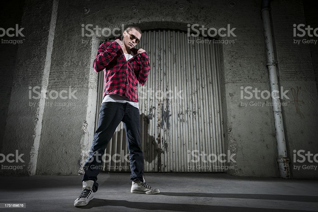 cool young man standing in the street royalty-free stock photo