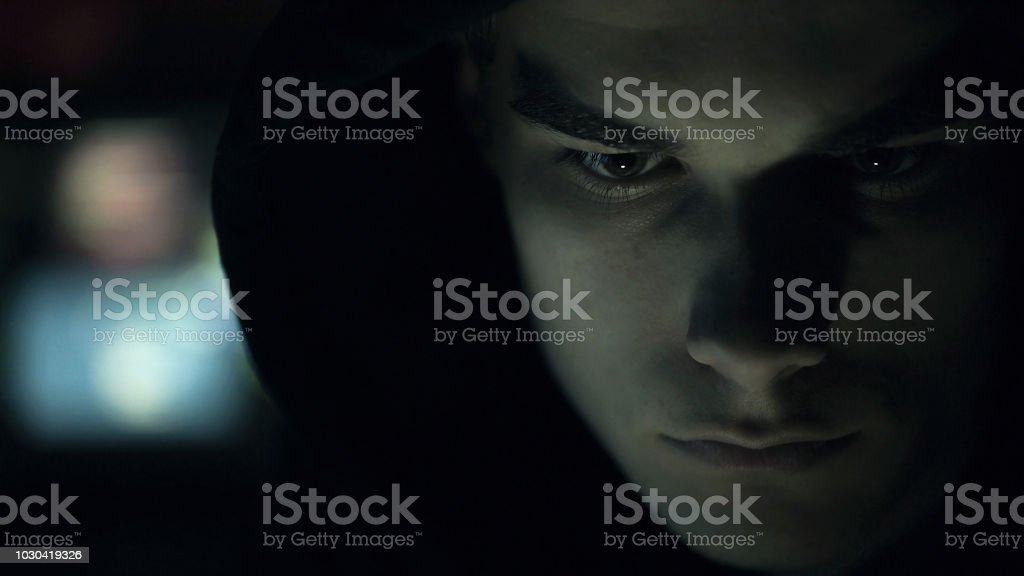 Cool your hacker portrait in the dark stock photo